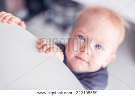 Tiny baby looking at the camera. Charming babe