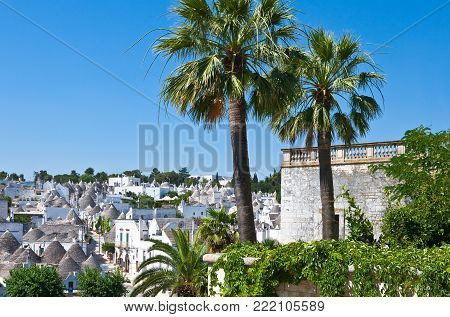 Alberobello, Italy - July 19, 2006: Panoramic view of the district with the Trulli dwellings