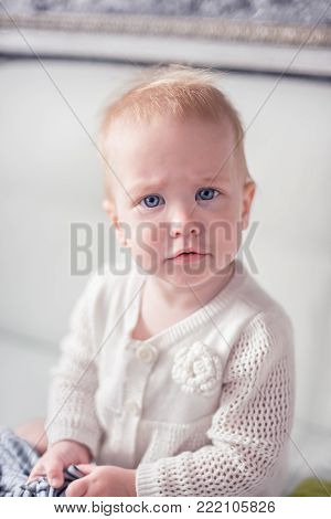 Cute sweet little infant with a blond hair. Nice kiddy