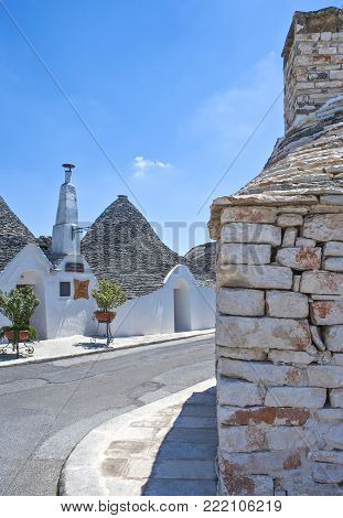 Alberobello, Italy - July 19, 2006: The Trulli, rural dwellings of medieval origin made with dry stones and conical roof