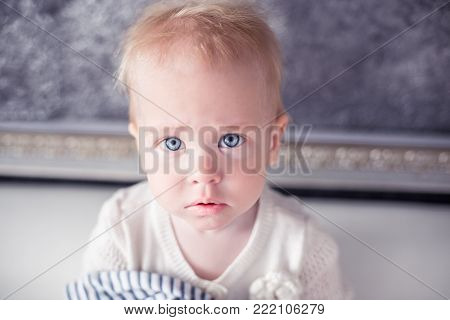 Lovable toddler with a blue eyes. Adorable kiddy