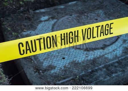 diagonal caution tape reading caution high voltage