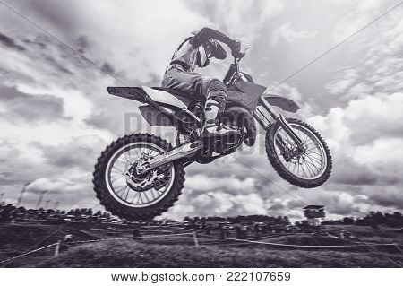 Dirtbike. Dirt bike extreme jump on motorcycle motocross, black and white