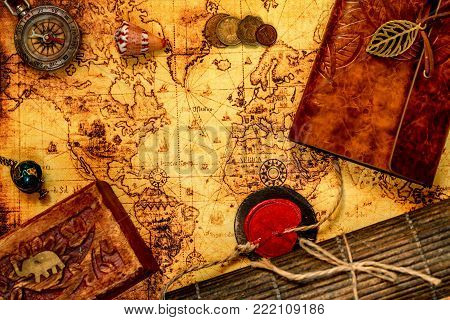 Ancient styled travel background. Wanderlust concept. Old log book, map and compass poster