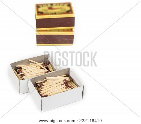 Match sticks with brown heads in stacks .  Matches texture background
