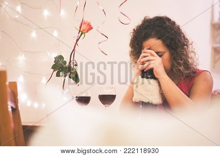 Portrait beautiful woman smile with a pink rose at restaurant on Valentines Day