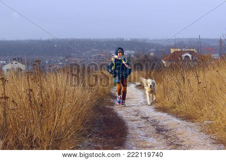 Dog Playing With Owner. Young Girl Playing With Her Pet Golden Retriever. Dog And Owner, Outdoor. Golden Retriever Playing  Outdoor.