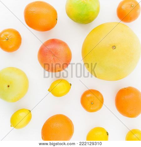 Citrus pattern made of lemon, orange, grapefruit, sweetie and pomelo on white background. Flat lay, top view.