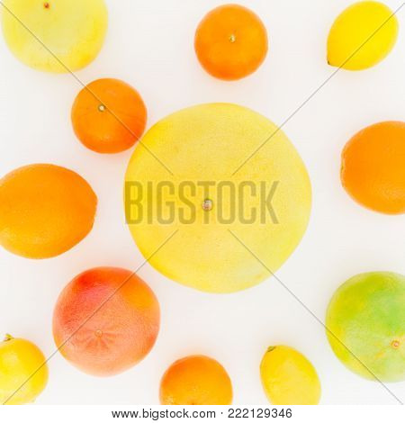 Fruit's background. Citrus fruits pattern made of lemon, orange, grapefruit, sweetie and pomelo on white background. Flat lay, top view.