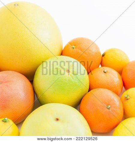 Citrus fruits - lemon, orange, grapefruit, sweetie and pomelo isolated on white background. Fruit's background