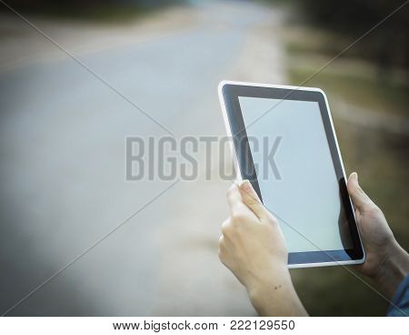 people and technology .closeup of person holding digital tablet. photo with copy space