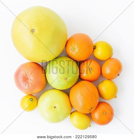 Lemon, orange, grapefruit, sweetie and pomelo on white background. Flat lay, top view.