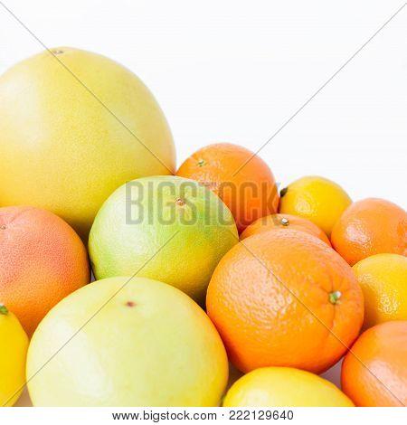 Citrus fruits - lemon, orange, grapefruit, sweetie and pomelo on white background.