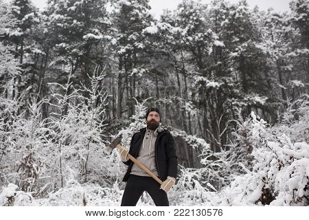 Snow Ball In Hand Of Blurred Bearded Man In Mittens