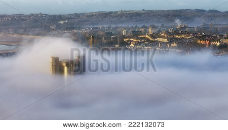 Editorial SWANSEA, UK - JANUARY 01, 2018: The British Telecom Tower rises up through an unusual morning strong fog that engulfed Swansea dropping visibility in the city to almost zero.
