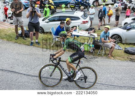 Col du Glandon, France - July 24, 2015: The French cyclist Pierre Rolland of Europcar Team,climbing the road to Col du Glandon in Alps, during the stage 19 of Le Tour de France 2015.