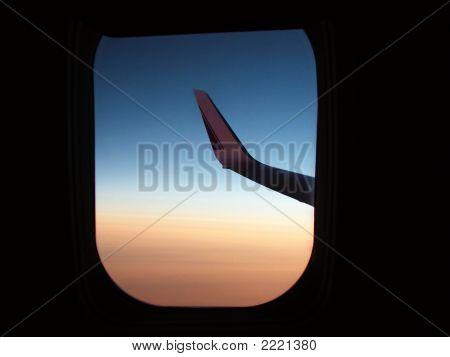 Dawn In A Window Of An Airplane