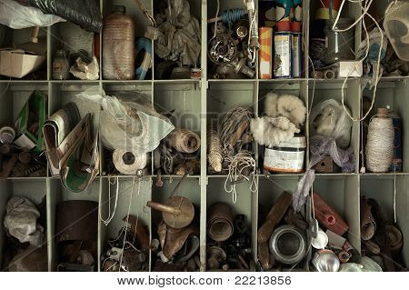 Different Tools And Accessories On Shelves In A Barn