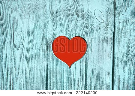 Red heart carved in a wooden board. Background