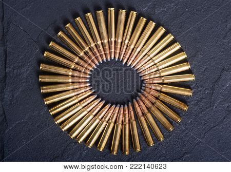 Bullets . Gun cartridge 8mm caliber on stone background poster