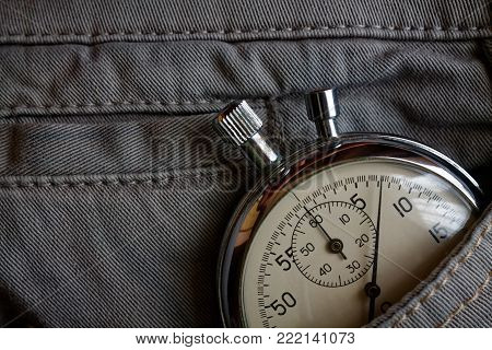 Vintage antiques Stopwatch, in gray denim pocket, value measure time, old clock arrow minute, second accuracy timer record poster