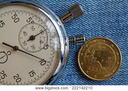 Euro Coin With A Denomination Of 50 Euro Cents (back Side) And Stopwatch On Blue Denim Backdrop - Bu