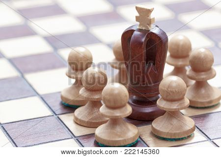 Business concept of win or defeat, loss, end of the game. Chessboard and figures of the fail king and pawns.
