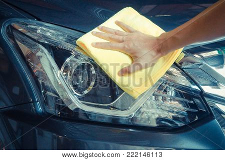 Cleaning car headlight with micro fiber cloth