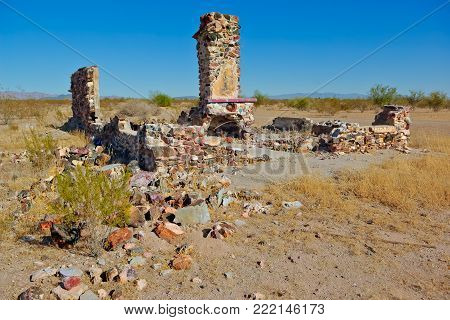 The ghostly remnants of an old homestead in Tonopah Arizona, now long abandoned and left to crumble into the desert.