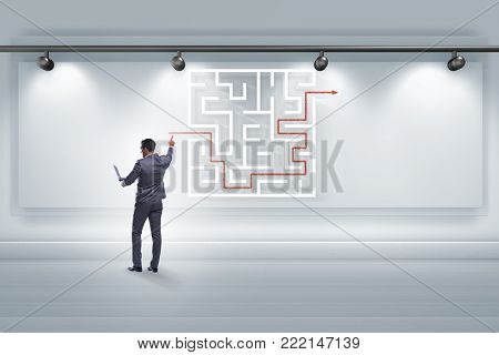 Businessman is looking for ways to escape from maze labyrinth