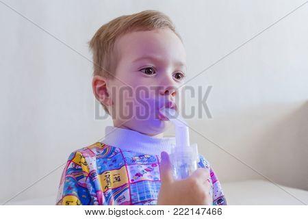 Small boy therapeutic inhalation using a nebulizer