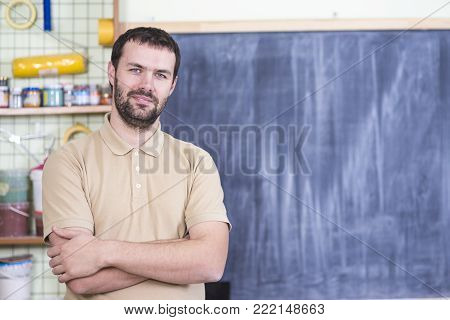 Portrait of Caucasian Handsome Man in Workshop.Horizontal Image Composition