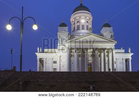 Travel Ideas and Concepts. Renowned Lutheran Cathedral in Helsinki on Senate Square Shot During Blue Hour in Finland.Horizontal Image