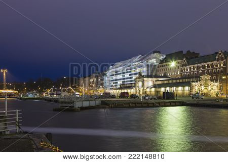 Helsinki, Finland - December 28, 2017: Central Quay of Helsinki in Front of the Famous City Market Hall (Hall Vanha Auppahalli) Opened in 1889 and Designed by Gustaf Nystrom in Helsinki, Finland
