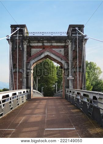 Huge,old bridge gate made from red bricks,lead out from the city Trevoux