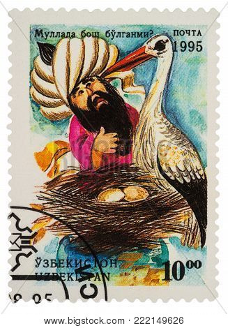 Moscow, Russia - January 15, 2018: A stamp printed in Uzbekistan shows scene from Asian fairy tale