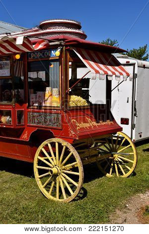 DALTON, MINNESOTA, Sept 8, 2017: Popcorn is for sale in an old decorated wood wheel coach located at the annual Dalton Threshing Bee farm show in Dalton held each 2nd full weekend in September where 1000's attend.