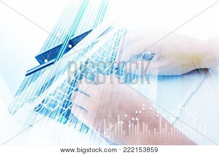 Closeup Of Man Hand Using Laptop On Office Desktop, Business Chart And Diagram With Abstract, Comput