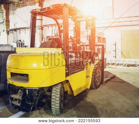 Forklift Truck inside warehouse or factory or logistics company, sunlight effect