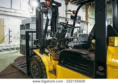 Forklift Truck inside warehouse or factory or logistics company