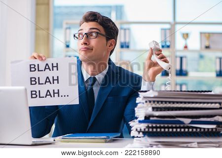Businessman with message in the office at desk
