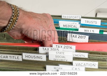 Close up of a well organized home filing system with tabs for each subject and focus on tax return papers for 2017