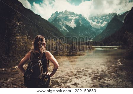 Woman enjoying amazing view of Lago di Braies.