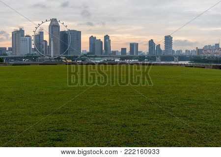 Marina Bay Sands, Singapore - May 23, 2017: Singapore Flyer View From Marina Barrage On Sunset Time