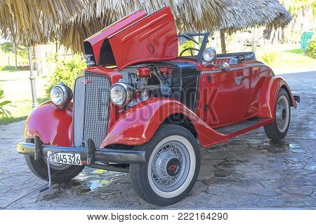 Varadero, Cuba - December 29, 2017: HDR American red Chevrolet Cabriolet classic car in Varadero Cuba