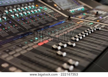 Close up view of digital audio mixing console. Selective focus.