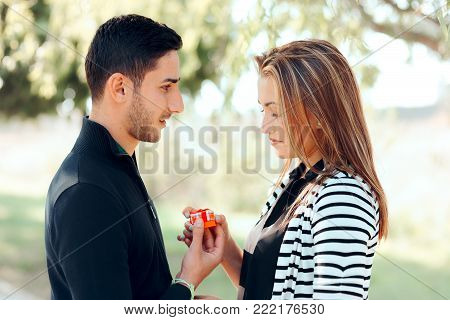 Sad Disappointed Girlfriend Receiving Small Valentines Gift From Boyfriend