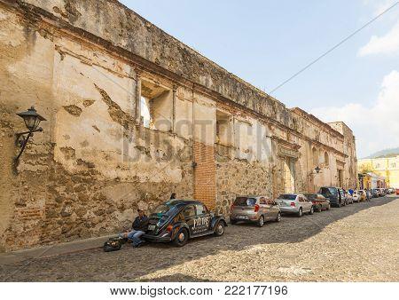 Antigua, Guatemala - January 21: The Historic Cobblestoned 5th Avenue North In Antigua Lined With Ca