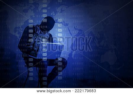 Terrorist is hacker in the dark breaks the access to steal information and infect computers and systems. concept of hacking and cyber terrorism.