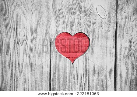 Red heart carved in a wooden board. Background. Postcard, valentine